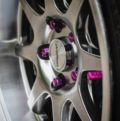 18x10.5 CP25 Wheels Hyper Black Finish close up with Purple Tuner Lug Nuts
