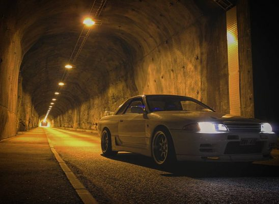 Nissan Skyline GTR R32 featuring 18x10.5 CP25 Wheels Hyper Black Finish with 265/35-18 Achilles Tires in tunnel