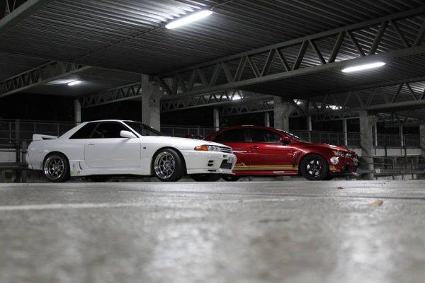 Nissan Skyline GTR R32 featuring 18x10.5 CP25 Wheels Hyper Black Finish with 265/35-18 Achilles Tires in parking garage